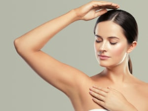 a lady with a smooth armpit after laser treatment